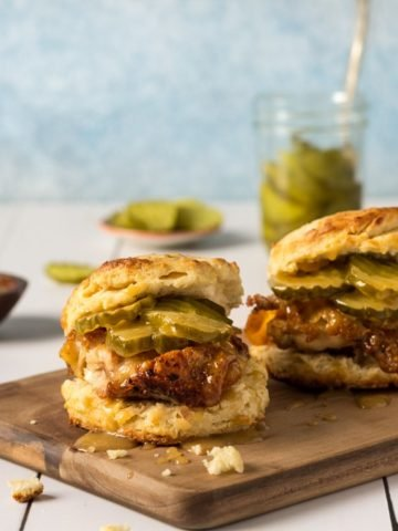 Chicken Biscuits Recipe with pickles on a cutting board