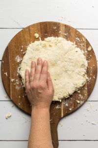 Southern Biscuit Dough rolled out on a wooden board