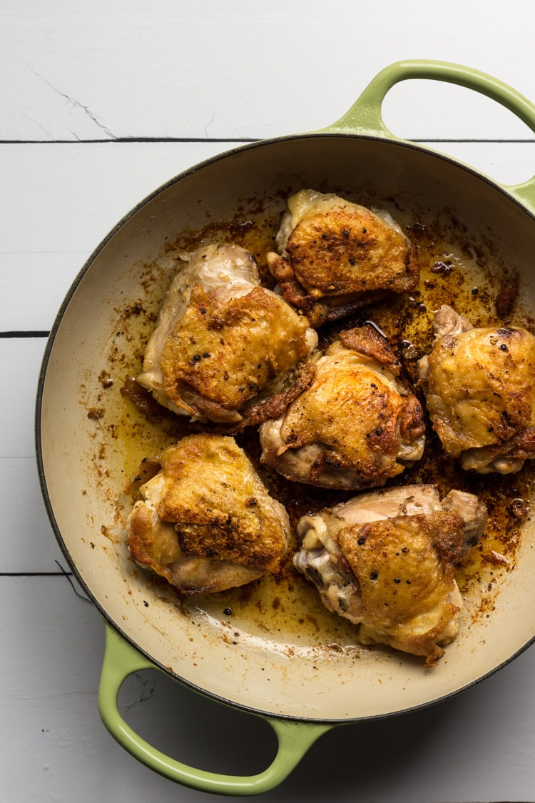 Chicken thighs sauteed in a saute pan