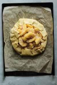 Peach crostata on a sheet pan