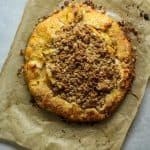 Peach crostata baked on parchment paper