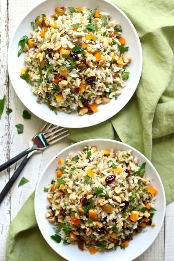 orzo and wild rice salad is packed with crunch from cashews, and tang from golden raisins and cranberries!