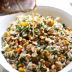 orzo and wild rice salad with a bright vinaigrette with orange juice, balsamic, and red wine vinegar!
