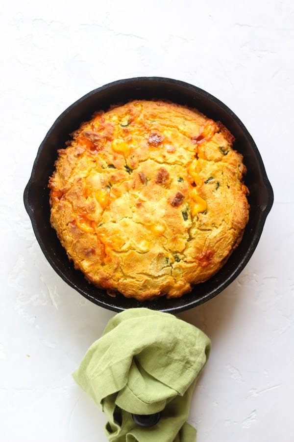 Gluten Free Poblano cheddar cornbread baked in a cast iron skillet