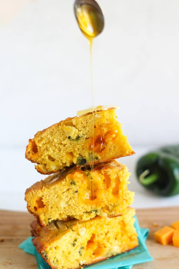 Cast iron poblano and cheddar cornbread drizzled with honey!