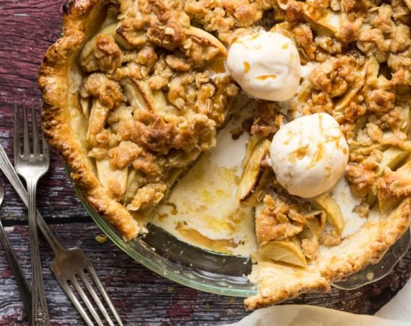Apple Streusel Pie sliced with vanilla ice cream