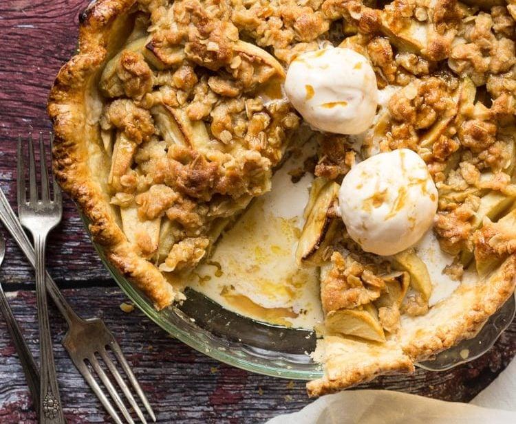 Apple Streusel Pie sliced with vanilla ice cream
