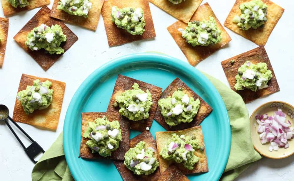 Goat cheese guacamole appetizer with crispy wontons