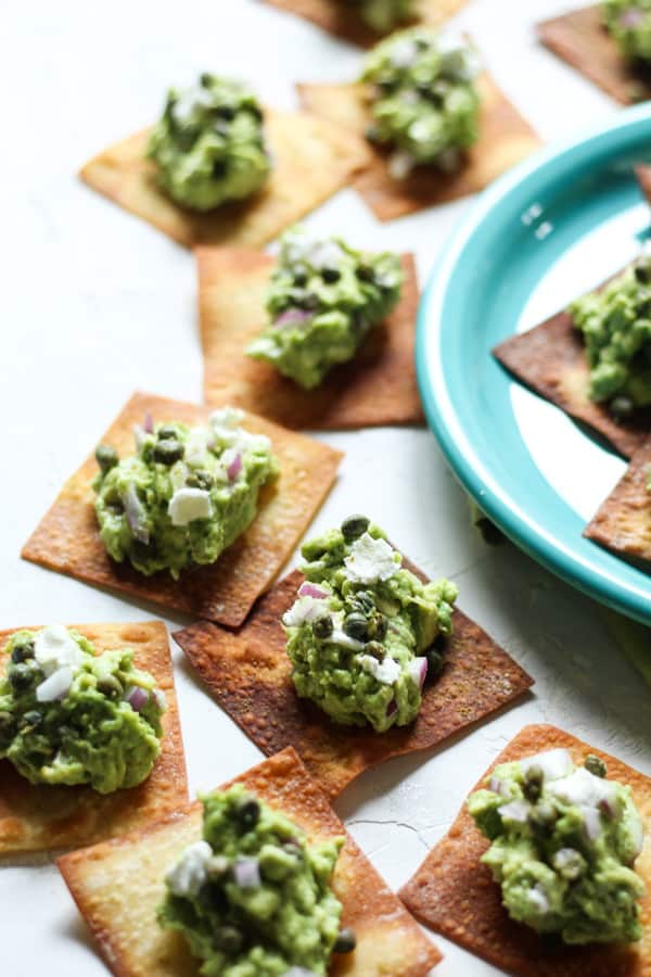 Goat cheese guacamole with capers and crispy wontons