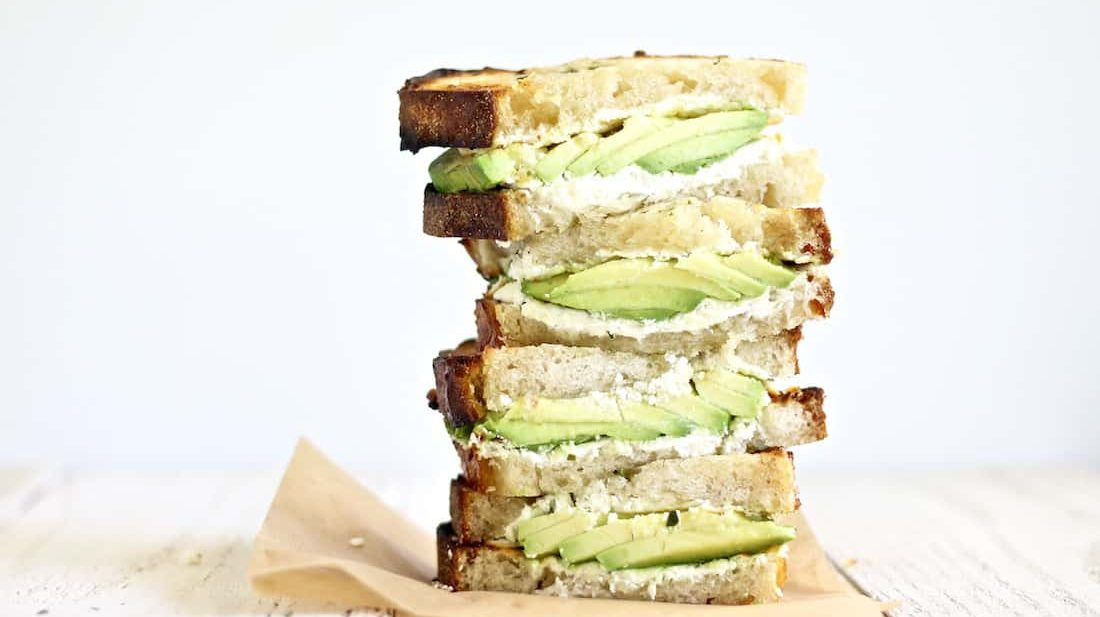 Grilled avocado goat cheese sandwiches with herbed butter