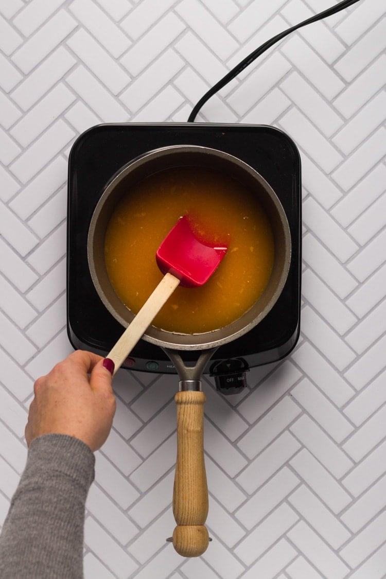 Orange juice in a saucepan for cranberry sauce