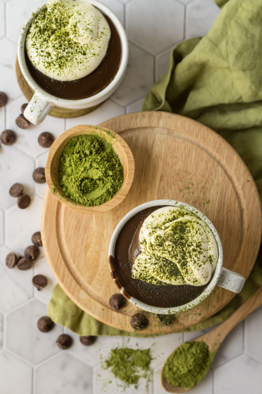 Matcha Hot Chocolate Recipe on a round wood board