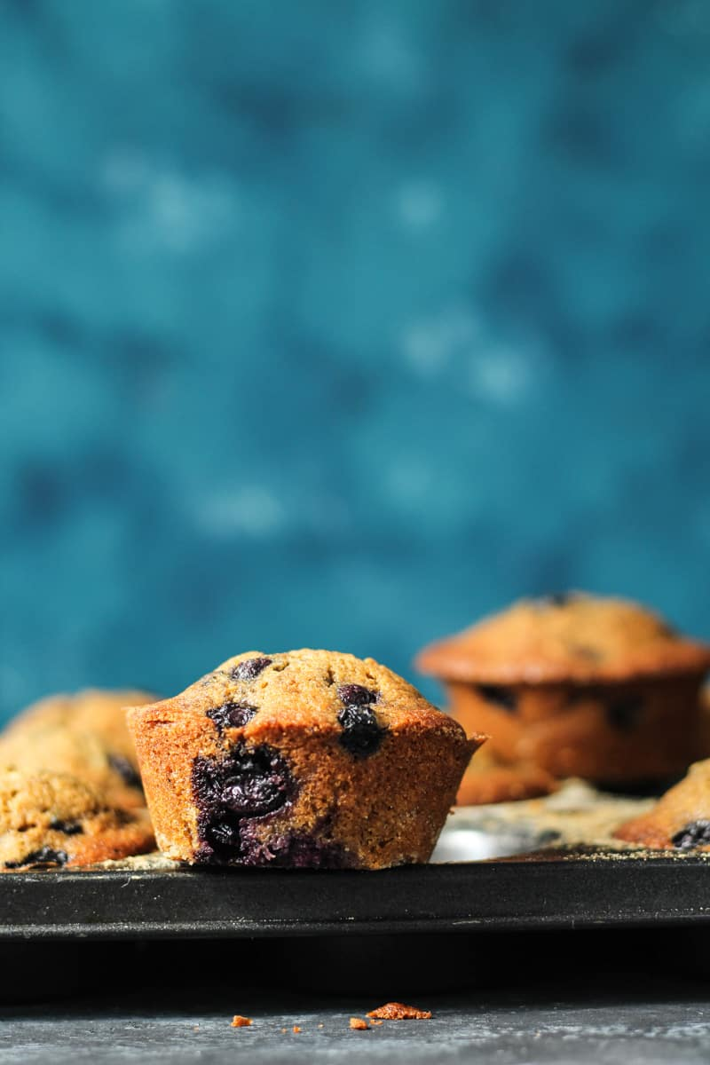 Blueberry Muffins with Coconut Oil sitting on a muffin pan