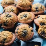 Blueberry Muffins with coconut oil and coconut sugar on a linen cloth