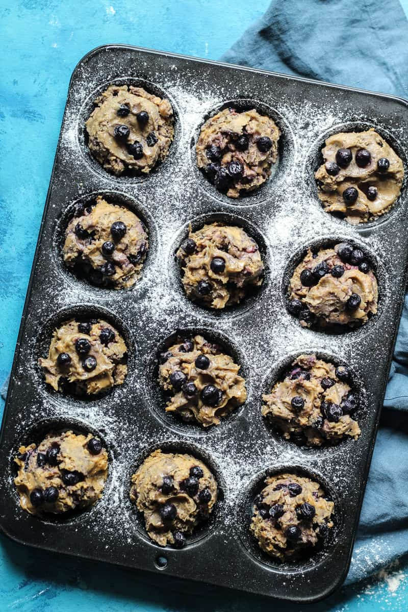 Blueberry Muffins with coconut oil scooped into muffin tins