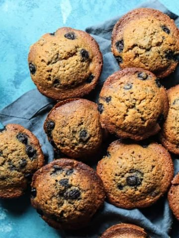 Blueberry Muffins with Coconut oil on a linen napkin