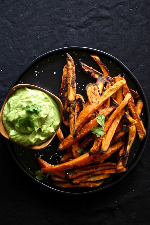 Smoky spicy baked sweet potato fries with avocado coconut dipping sauce