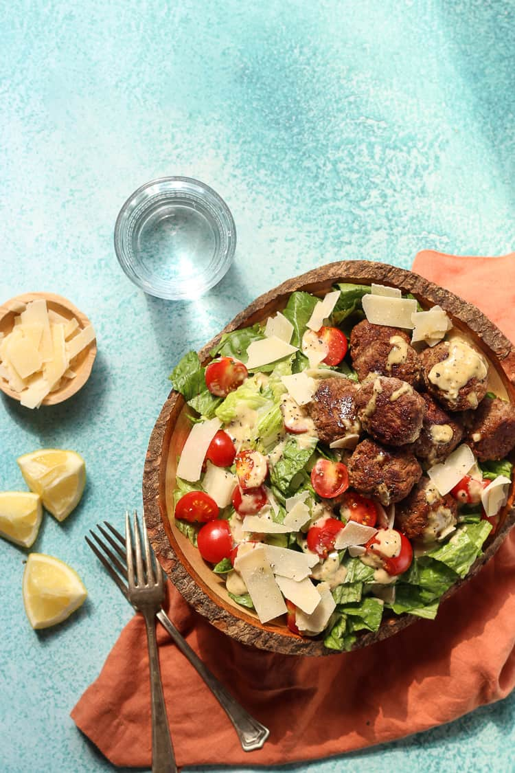 Easy Lamb Meatballs with caesar salad in a wooden bowl
