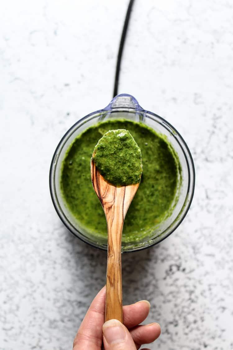 Green chili chimichurri sauce in a spoon