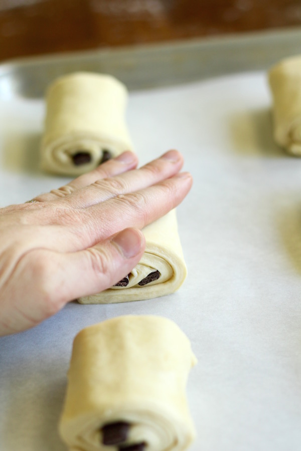 chocolate croissants pressed with hand