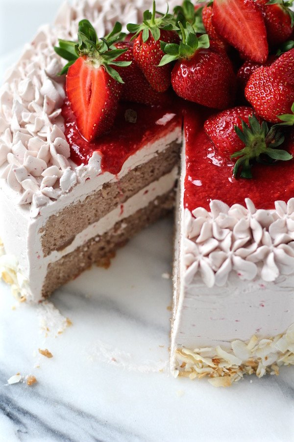strawberry cake strawberry buttercream sliced