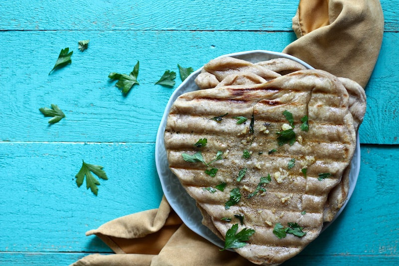 grilled garlic naan bread is the perfect flatbread for pizza, tacos, and as a side dish