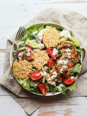 Healthy Chicken Caesar Salad with cheese crisps on a plate
