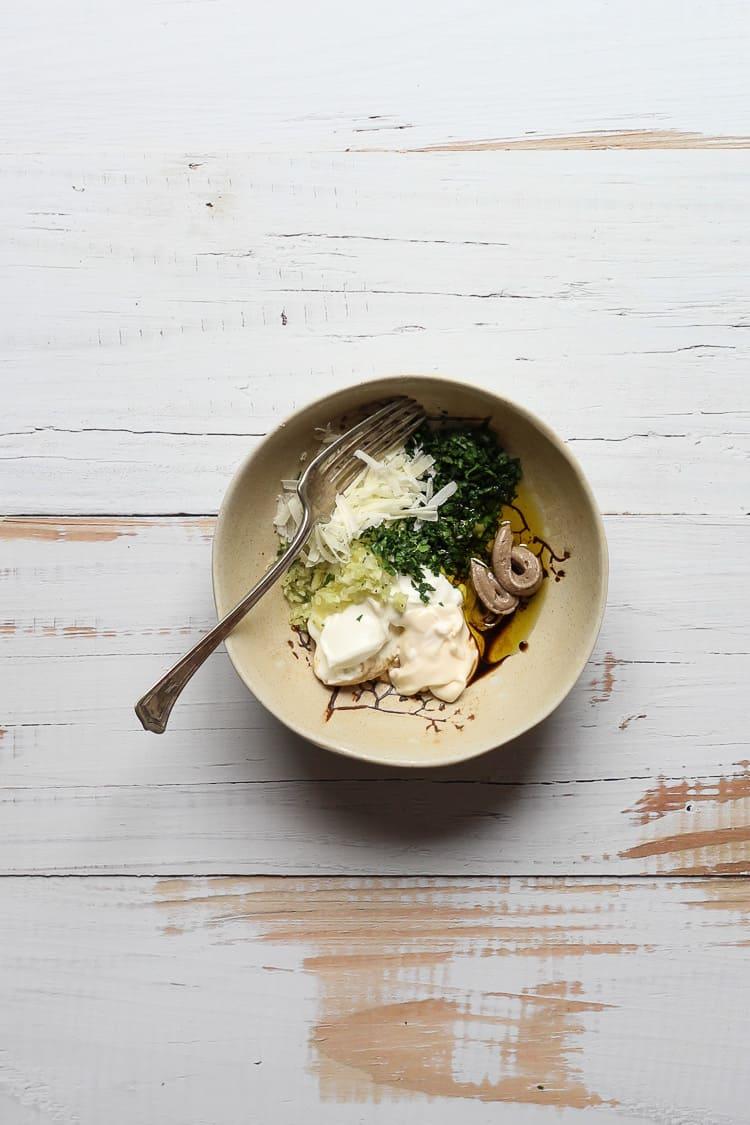 Healthy Caesar salad dressing ingredients in a bowl