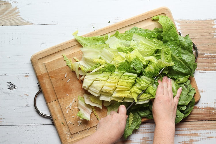 Romaine lettuced chopped on a cutting board