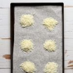 Shredded pecorino Romano crisps on a baking sheet