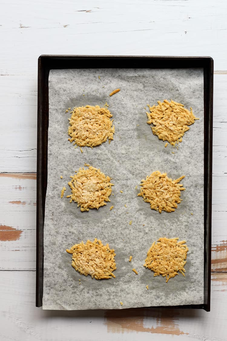 Baked Pecorino romano crisps on a sheet pan