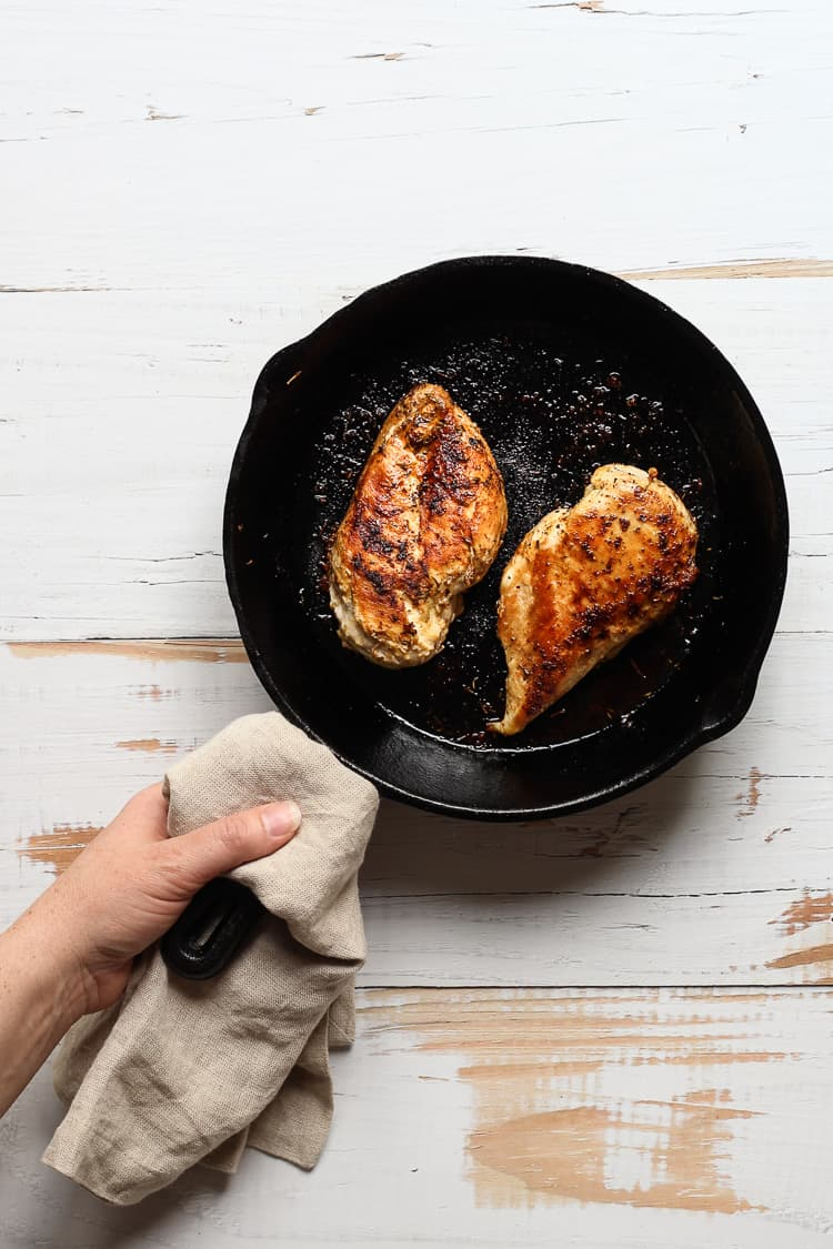 Grilled Chicken breasts in a cast iron skillet