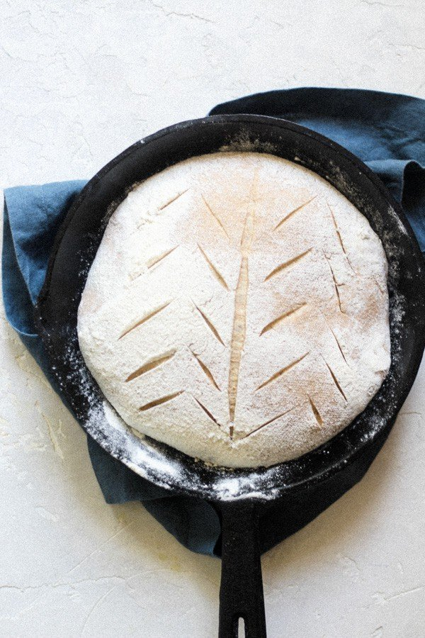 Artisan Sourdough Honey Spelt Bread Shaped in a cast iron skillet