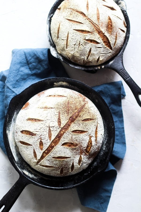 Earthy Soudough Honey Spelt Bread baked in cast iron skillets