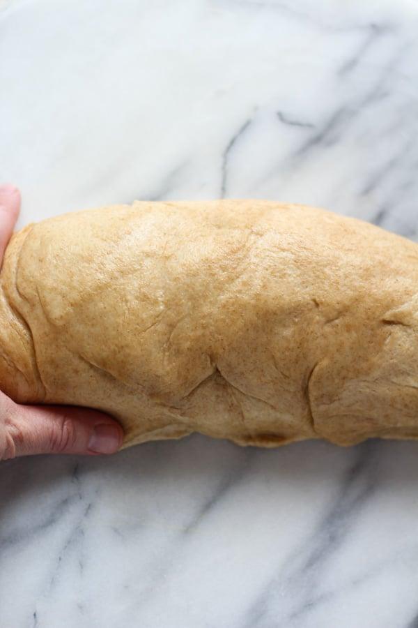Shaping Sourdough Spelt Brioche Bread in a loaf pan