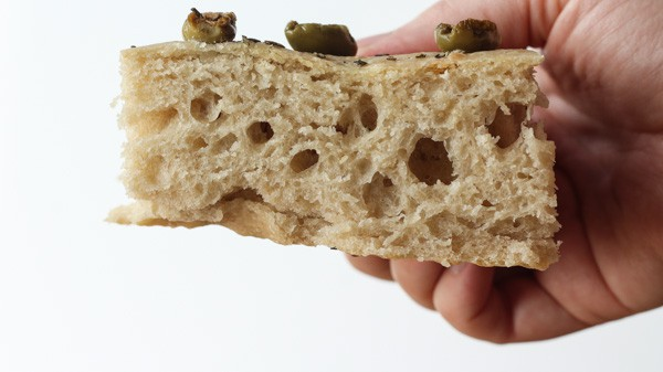 Sourdough Focaccia with loives and rosemary bread sliced