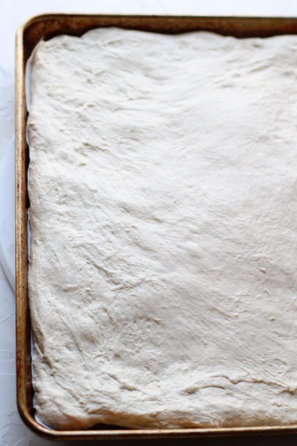 Sourdough Focaccia Dough shaped on a sheet pan