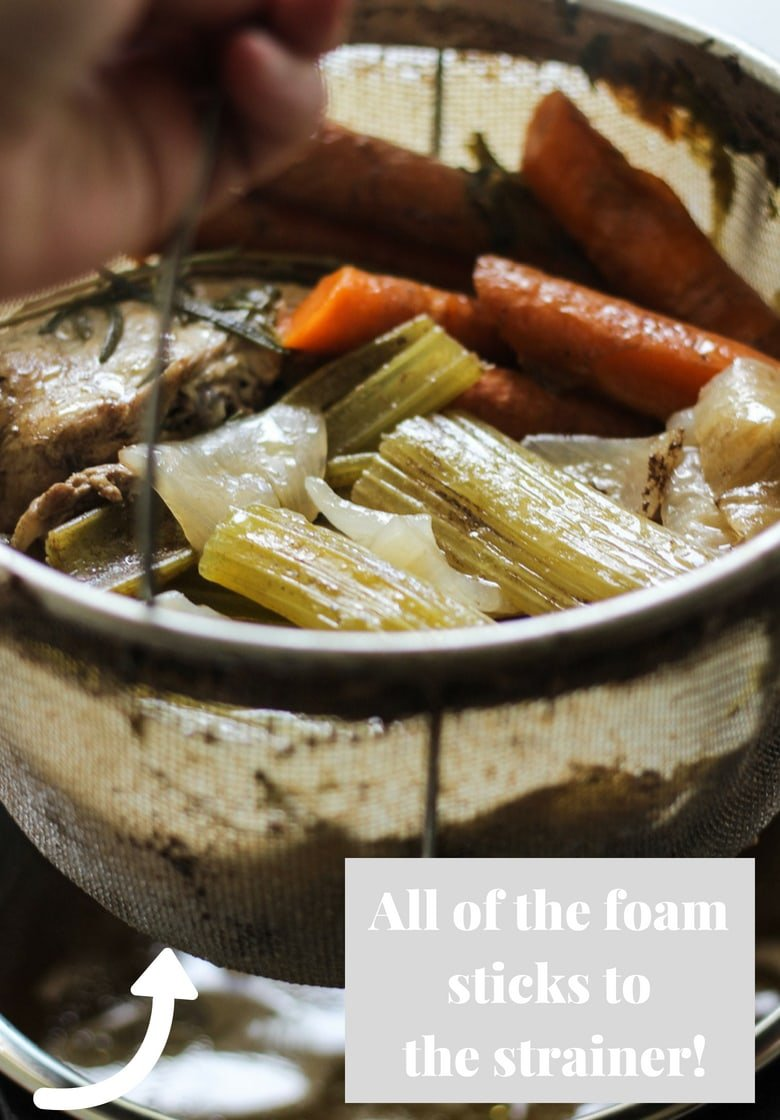 Instant pot strainer with chicken bone broth and veggies