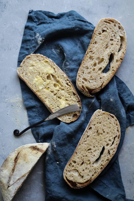 Sourdough bread recipe sliced with butter