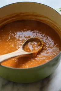 Thai pumpkin butternut squash soup simmering in a dutch oven