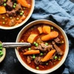 Bone Broth Instant Pot Beef Stew Recipe with carrots, onion, and peas