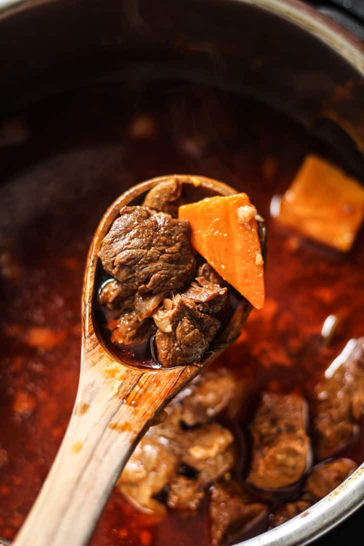 Instant Pot Beef Stew Recipe with carrots, onions, and herbs
