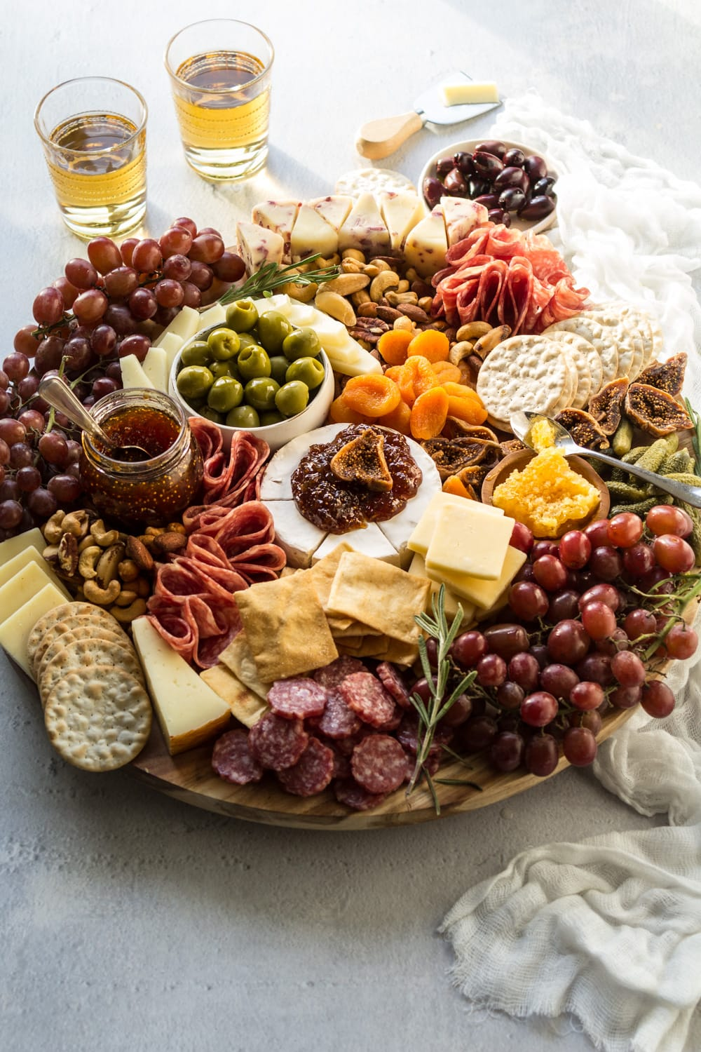 The best charcuterie cheese board with meats, cheeses, nuts, and dried fruit