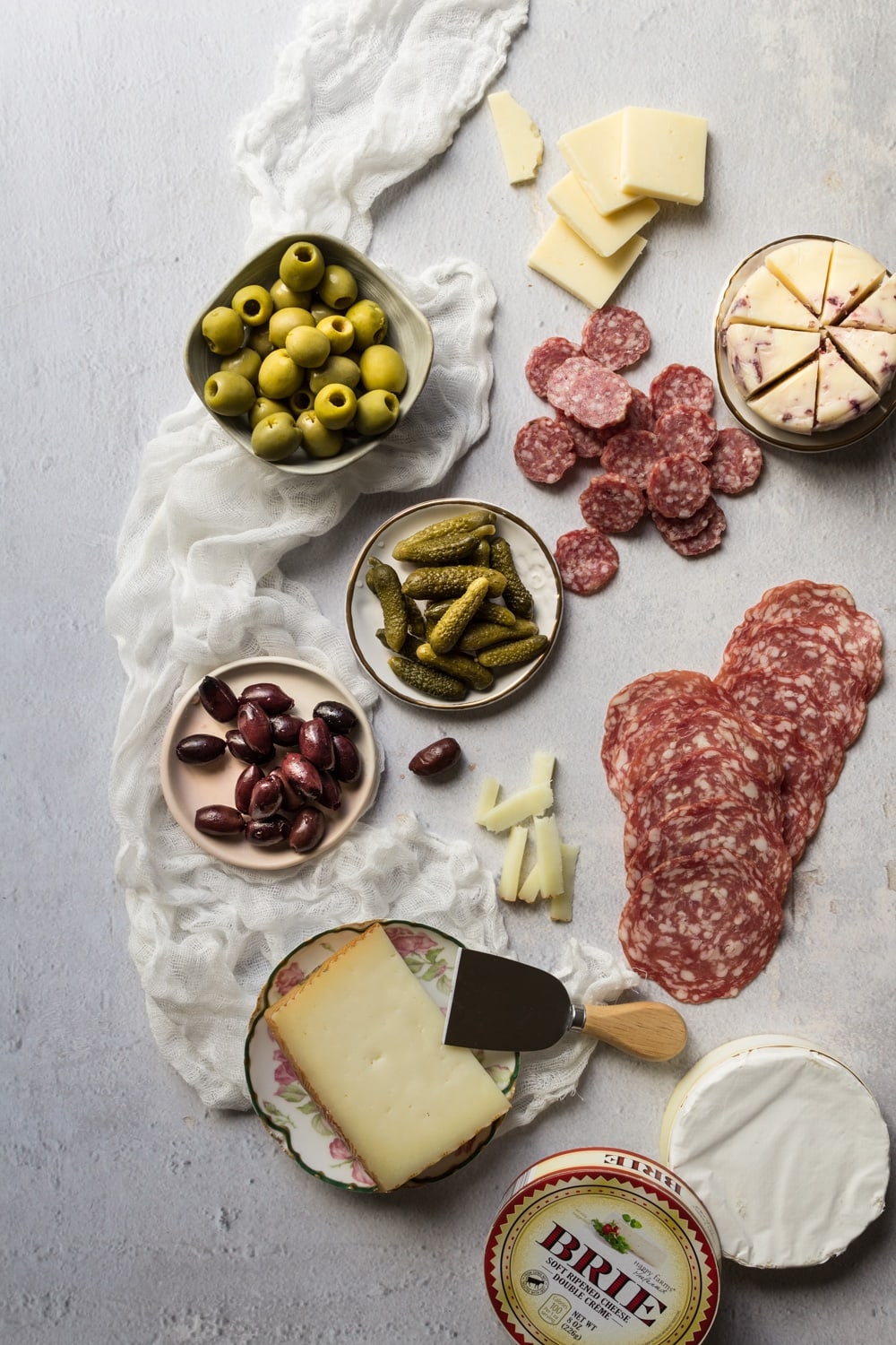 Olives, meats, and cheeses for a charcuterie board