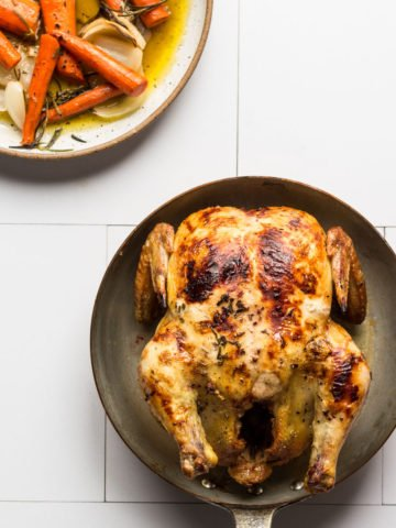 Roasted chicken in a pan with vegetables
