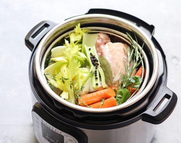 Vegetables and chicken bones in an instant pot