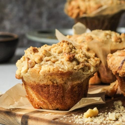 Banana nut muffins on a wooden cutting board