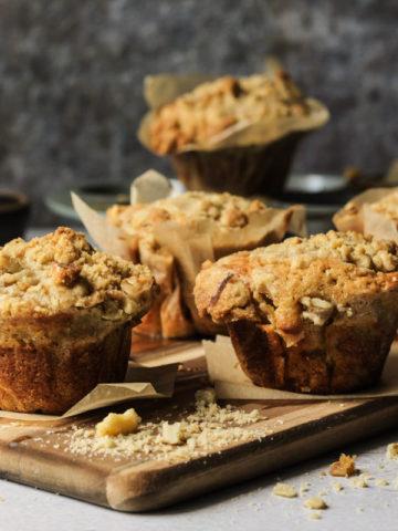 banana walnut muffins on a wooden cutting board