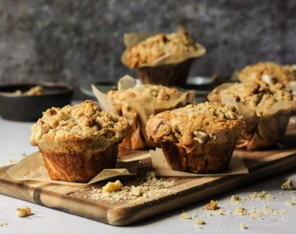 banana walnut muffins on a wooden cutting board