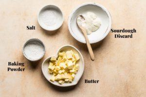 butter, baking powder, salt, and sourdough discard in bowls